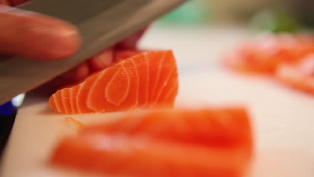 ms r/f sushiman slicing some salmon sashimis, typical brazilian night life / sao paulo, brazil - salmon stock videos & royalty-free footage
