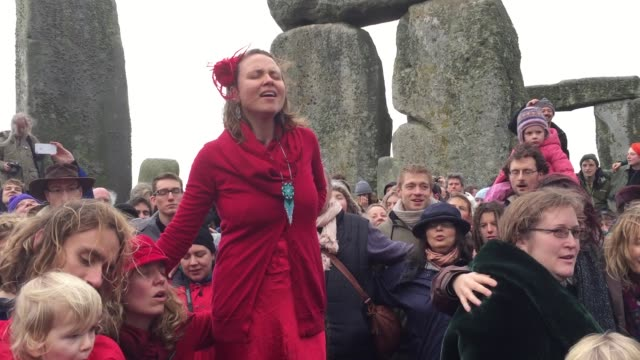susie ro prater leads the shakti sings choir as druids pagans and revellers gather in the centre of stonehenge hoping to see the sun rise as they... - paganism stock videos and b-roll footage