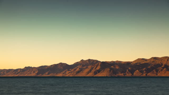 susnet on pyramid lake - timelapse - wide shot stock videos & royalty-free footage
