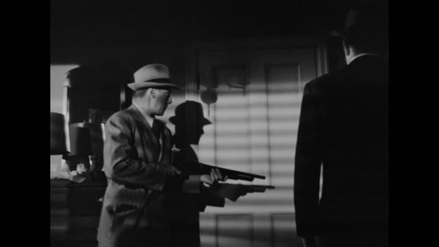 1948 a suspect escapes before police invade his house - film noir style stock videos and b-roll footage