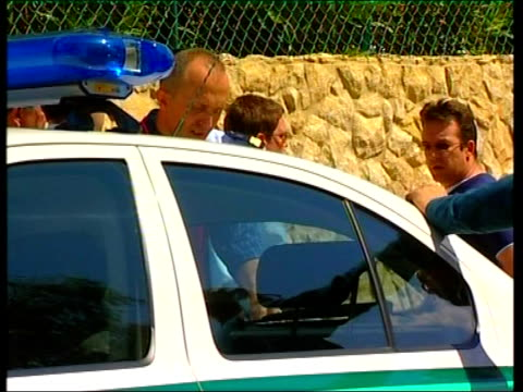 suspect in madeleine mcmann abduction named portugal algarve praia da luz robert murat chatting with police beside police car slow motion murat along... - praia stock videos & royalty-free footage