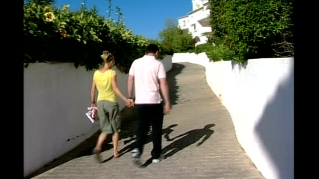 Suspect in Madeleine McMann abduction named Praia Da Luz Gerry McCann and Kate McCann along street hand in hand to BV
