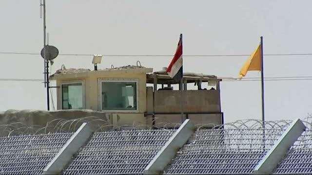Suspected Islamic militants killed in air strikes on Sinai Peninsula Soldiers guarding border area Close shot binoculars held by troop Watchtower at...