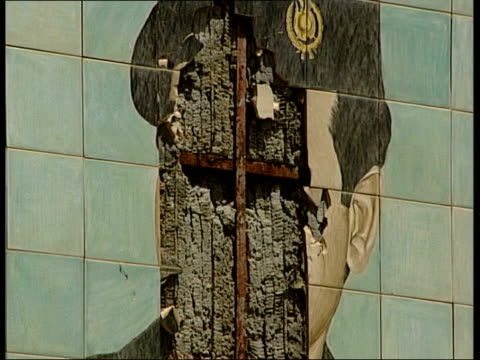 suspected saddam hussein recording released lib grafitti on wall ms damaged saddam hussein mural on wall la saddam statue with outstretched arm la... - saddam hussein stock videos & royalty-free footage