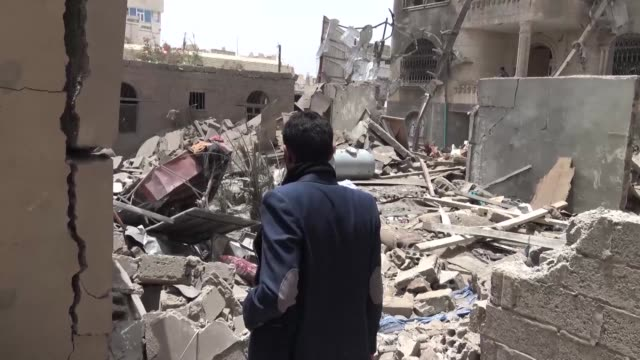 vídeos de stock e filmes b-roll de suspected saudi-led coalition air strike on yemen's rebel-held capital sanaa has killed four members of the same family according to medics and... - air raid