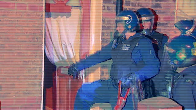17 suspects arrested by police in gang raids england london lambeth photography *** police from trident's central gangs unit using battering ram in... - weaponry stock videos & royalty-free footage
