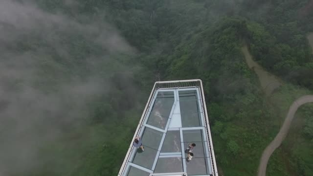 Suspended more than 120 metres above a gaping chasm the world's longest cantilevered glass skywalk is delighting and terrifying visitors in China