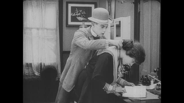 1917 Suspicious man (Buster Keaton) chases sneaky jewel thief down city street