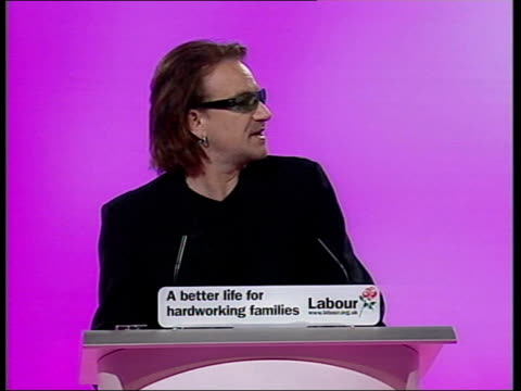 Sussex Brighton U2 singer Bono along onto stage for Labour Party Conference speech PAN TGV Audience Bono speech SOT You may kneel / My name is Bono...
