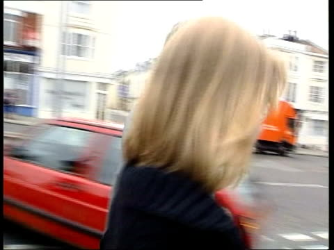 sussex police chief paul whitehouse resigns lib brighton ms whitehouse and daughter frances out of court whitehouse and frances along street... - paul whitehouse stock-videos und b-roll-filmmaterial