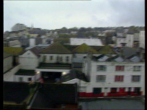 sussex police chief paul whitehouse resigns lib hastings rooftops of buildings pan to building where police carried out drugs raid and shot james... - paul whitehouse stock-videos und b-roll-filmmaterial
