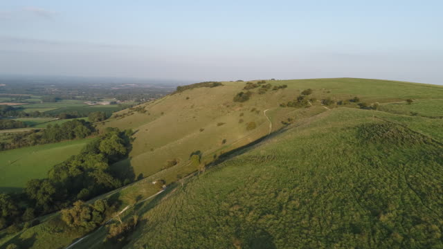 sussex south downs aerial view near ditchling beacon - collina video stock e b–roll