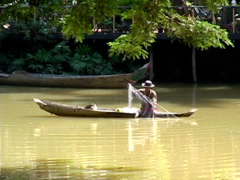 sustainable lifestyle: fishing from home build canoe - local produce stock videos & royalty-free footage