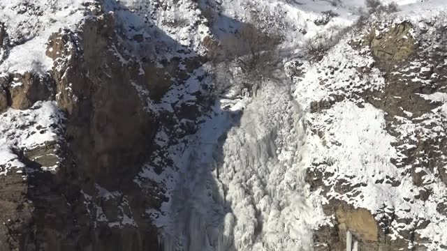susuz waterfall in the northeastern turkey has completely frozen on saturday, jan. 23 due to the cold weather in the region recently. rivers, ponds,... - winter stock videos & royalty-free footage