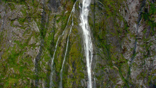 sutherland falls slow motion aerial - valley stock videos & royalty-free footage