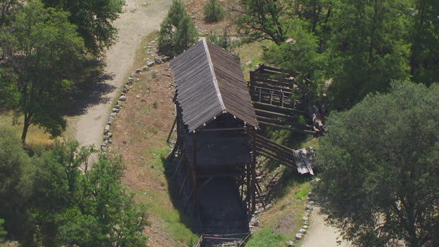 ws aerial pov sutter's mill and bridge at california - watermill stock videos and b-roll footage