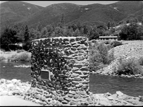 sutter's mill monument on the banks of the american river cu dedication plaque wooden sign 'near' the spot where james w marshall discovered gold - california gold rush stock videos and b-roll footage