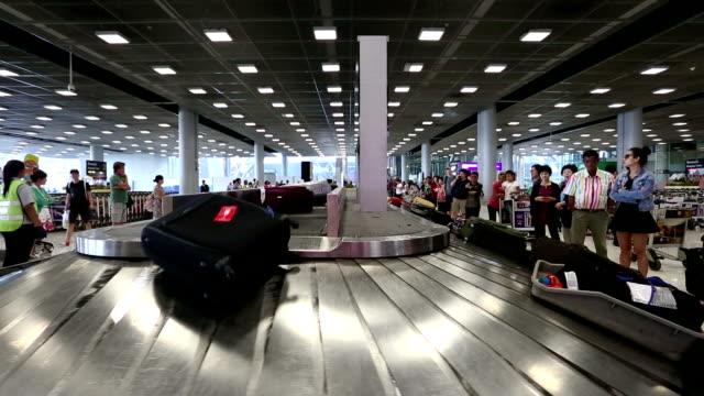 suvarnabhumi airport bangkok - baggage claim stock videos and b-roll footage