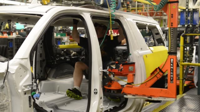 suvs are crafted by employees and robotic machinery alike at general motors assembly plant in arlington texas on wednesday and thursday march 9 10... - general motors stock videos & royalty-free footage