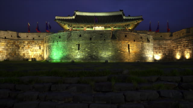 suwon hwaseong fortress (unesco heritage site) at night - suwon stock videos and b-roll footage