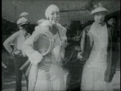 suzanne lenglen playing tennis against helen wills / cannes, france - 1926年点の映像素材/bロール