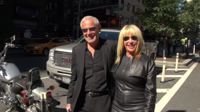 suzanne somers and her husband alan hamel pose for a photographer after leaving the outside set of extra in new york ny on 9/23/13 - suzanne somers stock videos & royalty-free footage