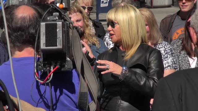 suzanne somers being interviewed on the outside set of extra in new york ny on 9/23/13 - suzanne somers stock videos & royalty-free footage