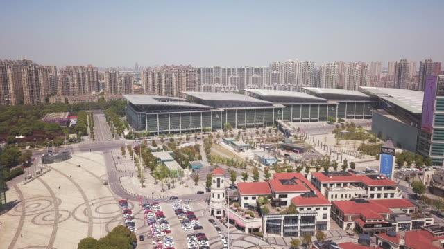 aerial suzhou international expo center, suzhou, jiangsu province, china - jiangsu province stock videos & royalty-free footage