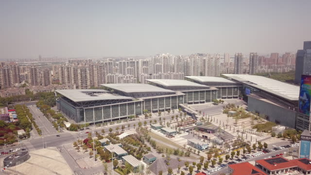 aerial suzhou international expo center, suzhou, jiangsu province, china - east china stock videos & royalty-free footage