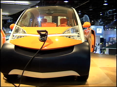 suzuki covie info sign at base of turntable / suzuki covie revolving on turntable 2002 suzuki covie concept car montage at cobo hall on january 15,... - alternative fuel vehicle stock videos & royalty-free footage
