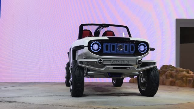 A Suzuki Motor Corp eSurvivor compact sports utility vehicle stands on display at the Tokyo Motor Show in Tokyo Japan on Wednesday Oct 25 Close up...