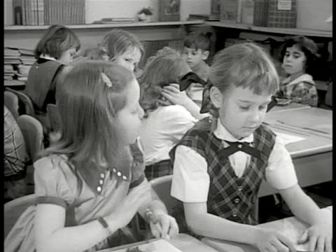 levittown pennsylvania dramatization 'suzy' asking girl next to her of she's new too girl replies 'no i've been here three days' la ms children... - levittown pennsylvania stock videos and b-roll footage