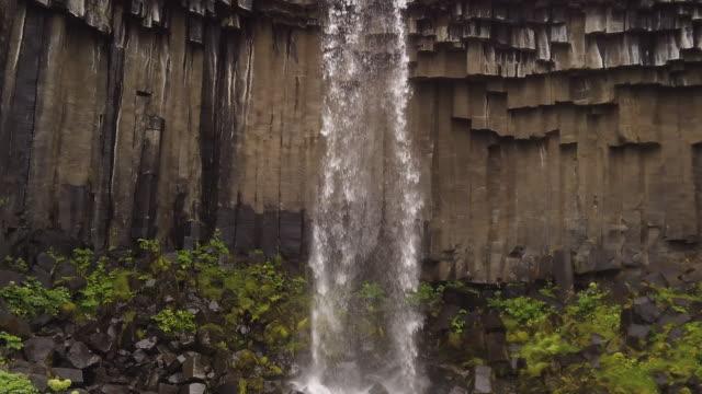 svartifoss waterfall, iceland - igneous stock videos & royalty-free footage