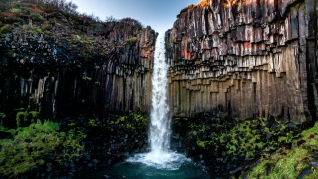 slow motion : svartifoss waterfall iceland - waterfall stock videos & royalty-free footage