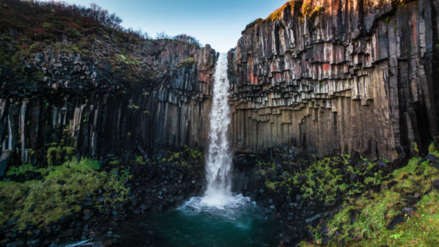 svartifoss waterfall in iceland - slow motion - rock formation stock videos & royalty-free footage