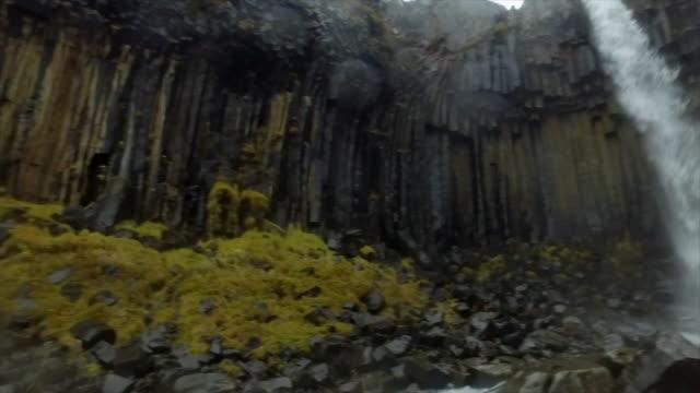 Svartifoss Waterfall in Skaftafell in Vatnajokull National Park river flowing in Iceland, Europe. - Slow Motion