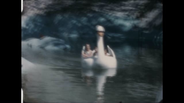 swan boat ride at santa's village from a home movie archive - home movie stock videos & royalty-free footage