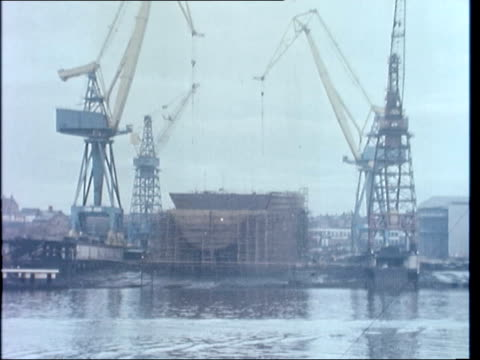 swan hunter shipyards may lose polish order wallsend swan hunter shipyard gv ship in stocks out as base of cranes moves lr ms hoist moves pull out gv... - hochziehen stock-videos und b-roll-filmmaterial
