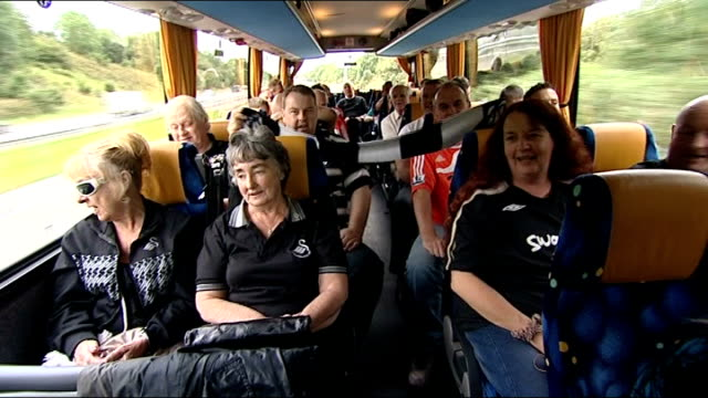 Swansea City prepare for their first Premiership match WALES INT Swansea City fans seated on coach bound for Manchester