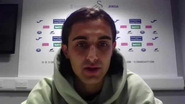swansea footballer yan dhanda accuses social media firms of 'adding fuel to fire' after racist abuse; england: int yan dhanda 2 way interview via... - news not politics video stock e b–roll
