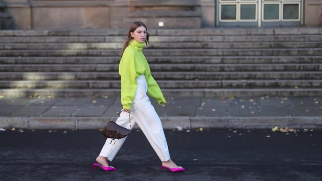 swantje soemmer is seen wearing neon turtleneck knit zara white high waist pants sportmax brown dior saddle bag pink paul andrew slingbacks shoes on... - turtleneck stock videos & royalty-free footage