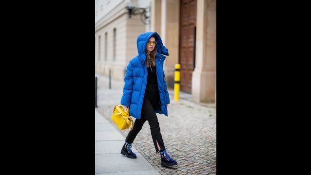 Swantje Soemmer is seen wearing royal blue down feather coat Woolrich black jeans Boden yellow bag Sophie Hulme Edited boots Marc Jacobs sunglasses...