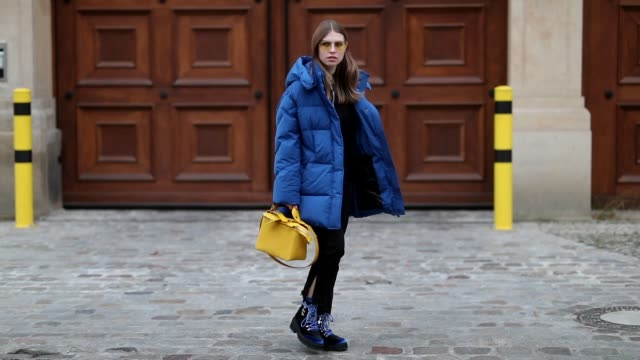 swantje soemmer is seen wearing royal blue down feather coat woolrich black jeans boden yellow bag sophie hulme edited boots marc jacobs sunglasses... - coat garment stock videos & royalty-free footage