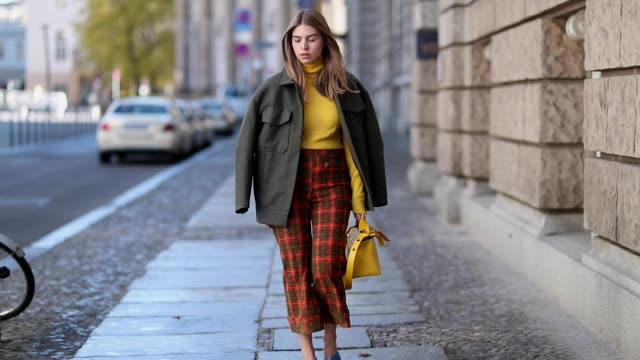 swantje soemmer is seen wearing yellow mustard sweater stefanel grey jacket edited plaid cropped pants zara yellow mustard bag sophie hulme blue no... - grey jacket stock videos and b-roll footage