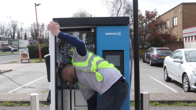 swarco ag employees inslall ev rapid charging units on street in canterbury, u.k. on thursday, april 8, 2021. - automobile industry stock videos & royalty-free footage