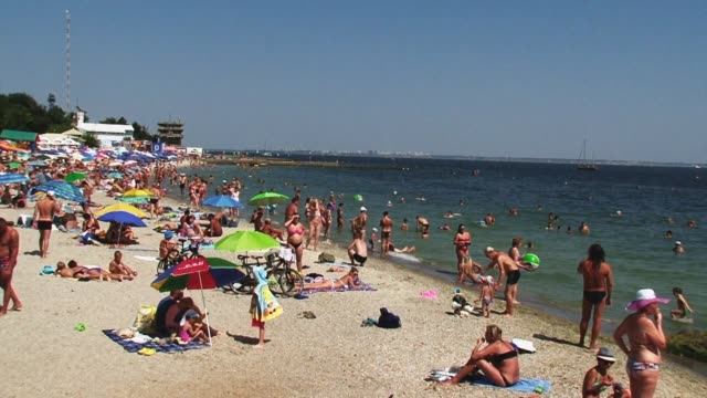 Swarms of tourists lounge on the beaches of Odessa