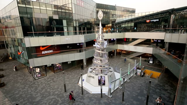 A Swarovski style Christmas tree sculpture in Sanlitun Village which is a famous fashion shopping street in Beijing