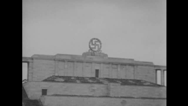 swastika blown up on the nuremberg stadium. - nazi swastika stock videos & royalty-free footage