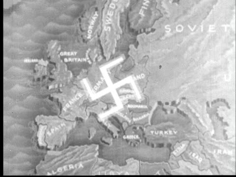 vídeos de stock e filmes b-roll de swastika growing out from germany over rest of europe/ pan to asia w japanese imperial sun spreading out over asia - 1942