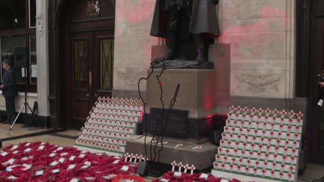 swathes of poppy wreaths have been delivered on great western railway trains and carried to london paddington station on remembrance day. nine train... - remembrance day stock videos & royalty-free footage